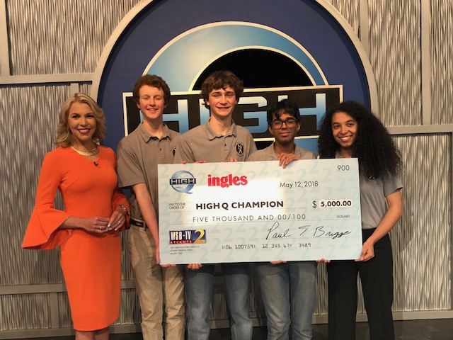 "Brain Game: Members of the champion North Atlanta ""High Q"" team members pose with show host Katie Walls, a WSB-TV meteorologist. Teams members are Quint Gfroerer, Jake Churchill, Ishaan Ghosh and Devon Gates."