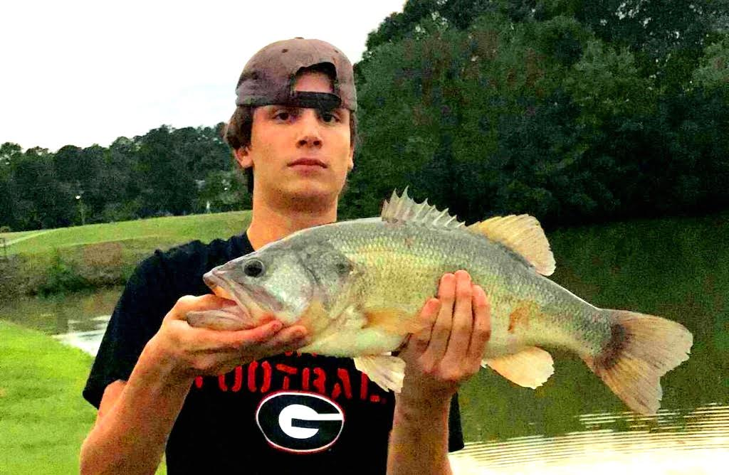 Catch A Break: Junior Jack Kiefer takes the oppor-tuna-ty over the summer to go fishing at the NAHS lake.