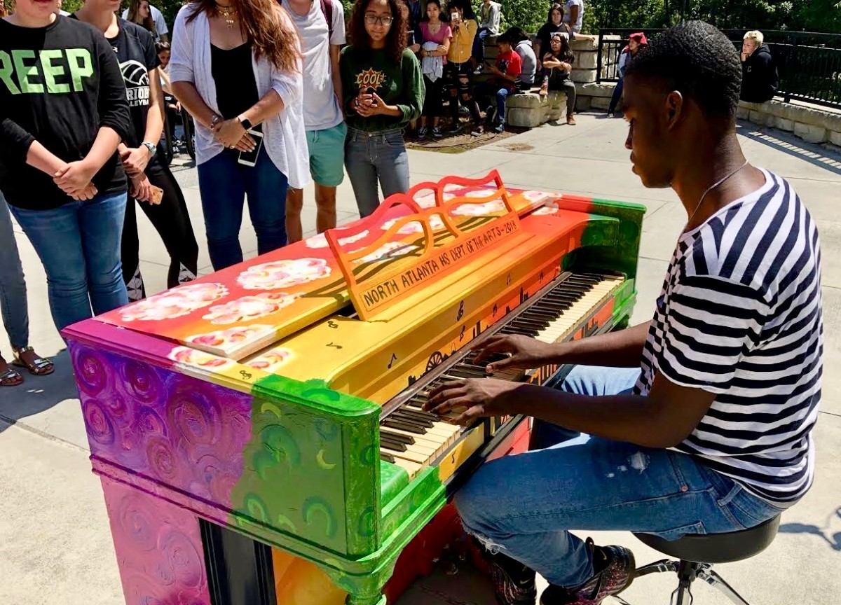 Playing With Paint: Senior Christopher Robinson performs on the piano for the