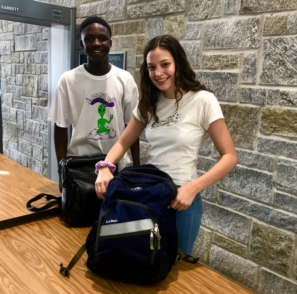 Safety First: Students like Juniors Anna Topfl and Lamin Bojang deal with the new security policies that have been implemented in North Atlanta.