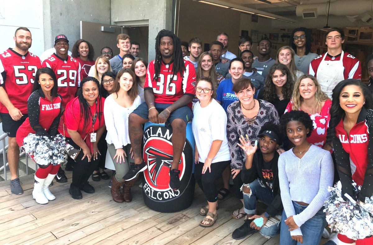 Falcon Fine Art: North Atlanta arts and athletics students celebrate the start of the new Student Athlete Art Leadership Team with the Falcons program, Hometown Huddle.