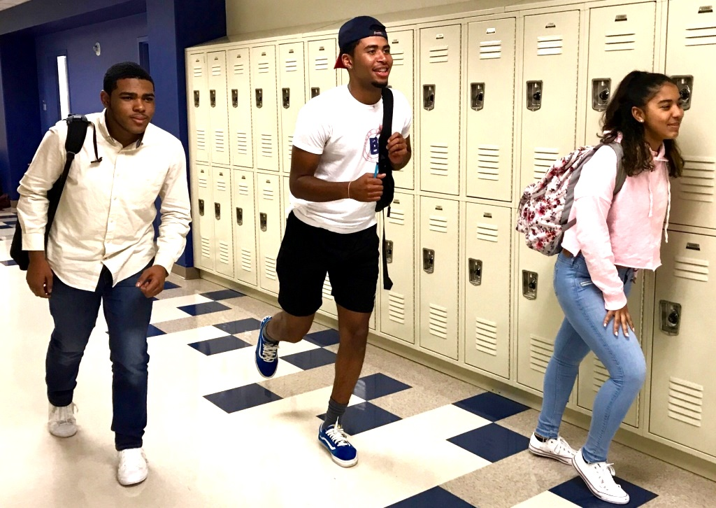 Too Little Too Late: Junior Yasiah Jamison, senior Joshua Johnson and junior Giannys Roman race to class in order to avoid the weight of the new tardy policy bearing down upon them.