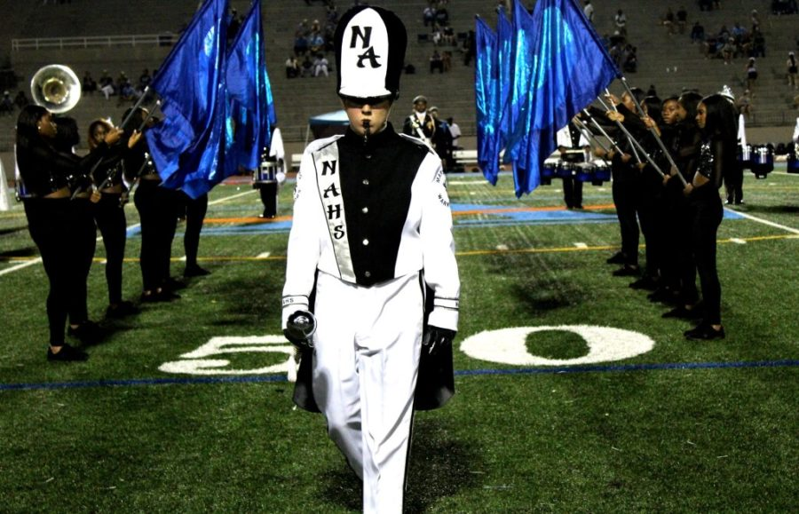 March+Up+to+the+Top%3A+Senior+drum+major+Emmett+Galloway%2C+along+with+the+rest+of+the+marching+band%2C+celebrate+their+win+of+a+third+rank+in+the+National+High+Stepping+High+School+Marching+Band+Competition+finals.+