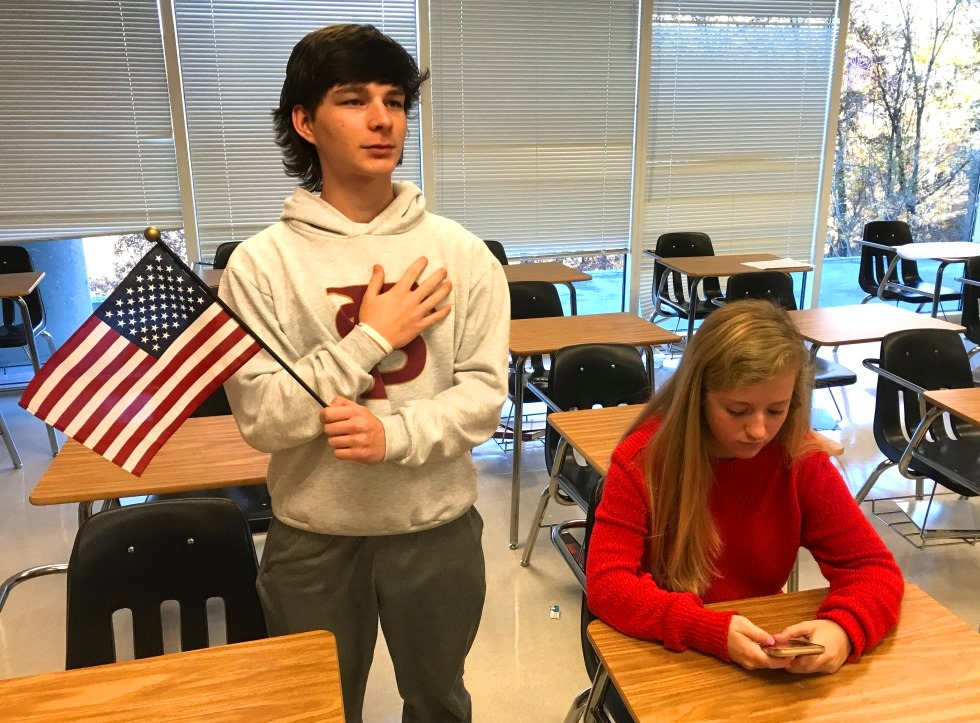 To Sit or Stand, That Is the Question: Sophomores Mark O'Meara and Graham Barnett choose to either sit or stand for the morning Pledge of Allegiance.