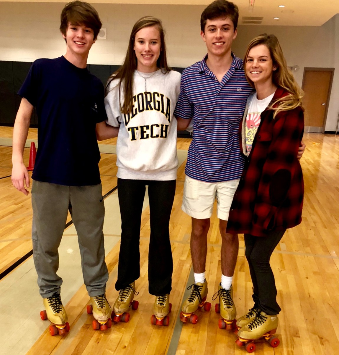 Hot on Wheels: Freshman Bryce McGowan, and Sophomores Lily Jones and Tyler Hankin roll their way through the P.E. roller skating curriculum.