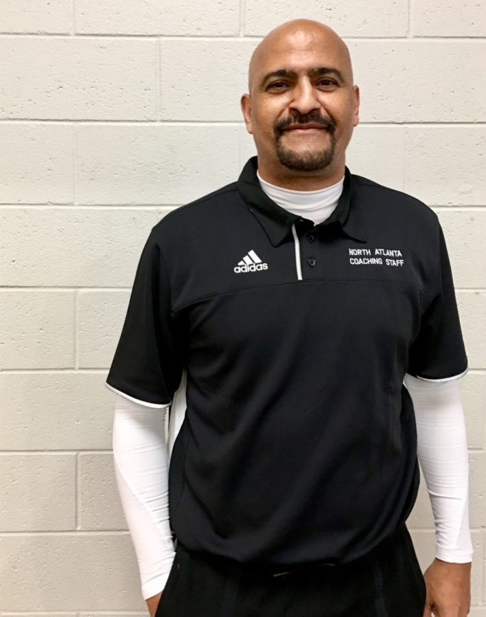 Head Shot: Coach Kerry Sarden. Vice President of Operations at the SaMarc Dream. All-State point guard in the state of Michigan. World's greatest basketball coach. This man has it all.
