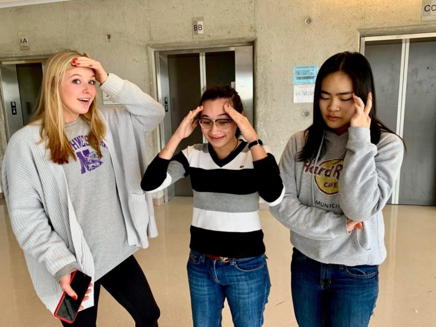 Crushed: Juniors Jessica Simmons, Emily D'Achiarti, Fiona Liu struggle with the pressures of junior year, coming with the wonderful package of testing, essays, and a workload of assignments.