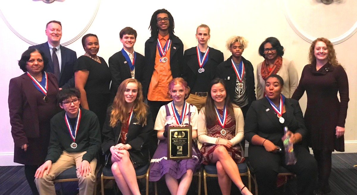 Academic Achievers: The Academic Decathalon team gathers together after winning the state-level Decathalon competition.