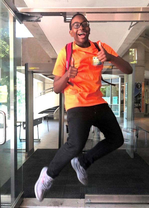 Dubs' Delight: Like many of his peers, freshman Jaden Gaillard leaps for joy at the thought of the school year ending.