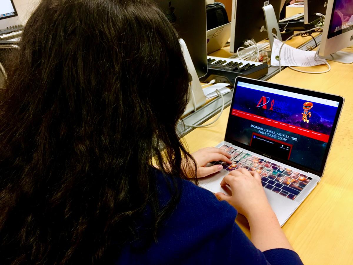Virtual School: Senior Caroline Tuelmer browses through the Atlanta Virtual Academy that many other North Atlanta students take over the summer.