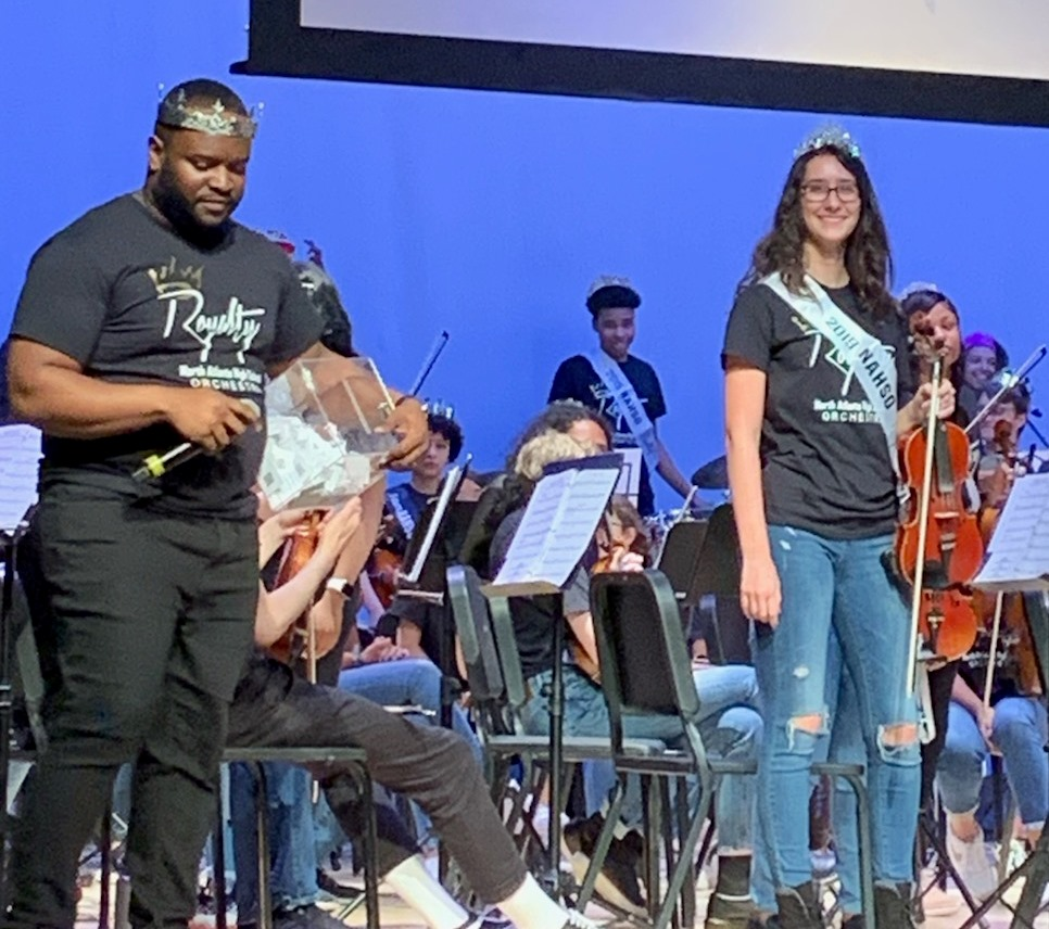 Senior Moment: Violinist Lila Ward was one of many orchestra seniors honored during the April 25 Spring Concert. She is shown on stage here with orchestra director Stephen Lawrence.