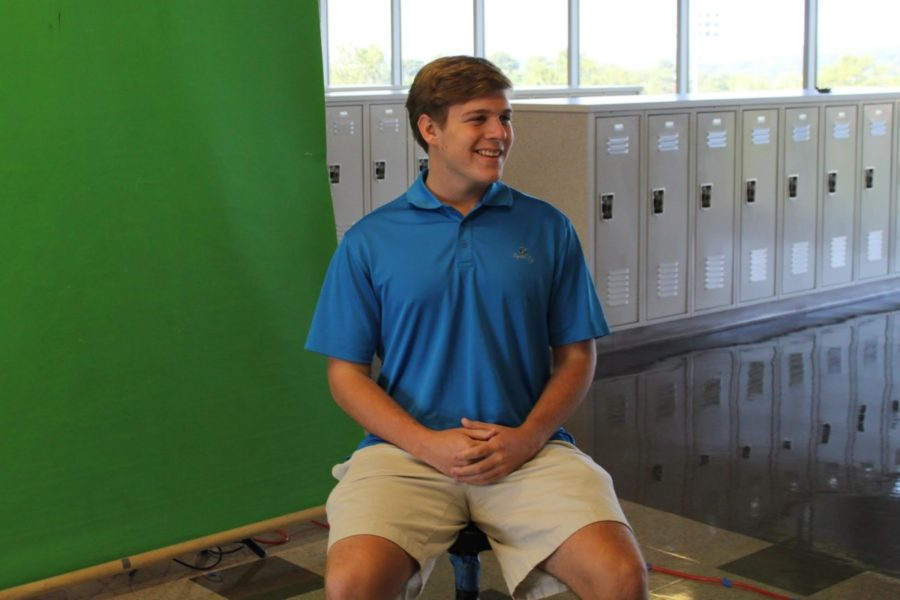 Say Cheese: Junior Matt Love smiles big as he gets his picture taken