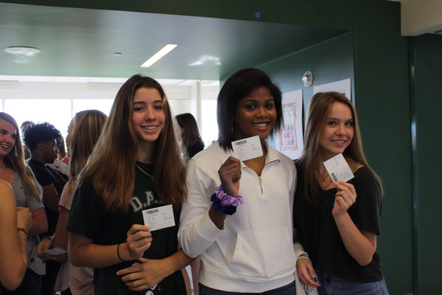 Smiles Ready!: Sophomores Aislin Ward, Avery Horton, and Julie Barfield gear up to take their yearbook photos.