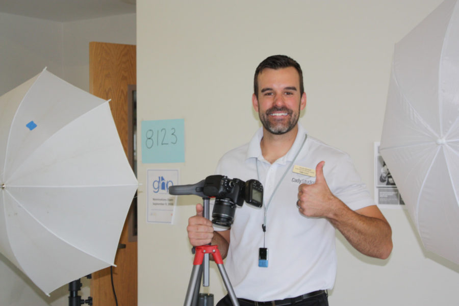 Thumbs-up: A Cady Studios photographer smiles for the Warrior Wire cameras between photos.