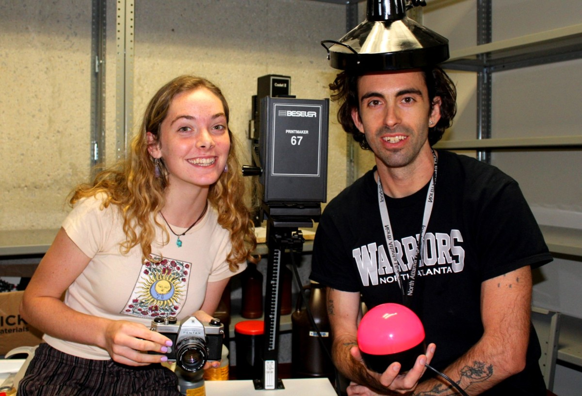 Shot in the Dark:Junior Skylar Charlesworth and art instructor Jordan Grimes make use of the new photography dark room