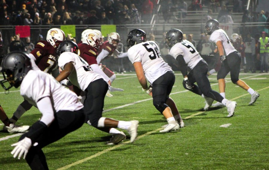 Lunging Line: During second quarter action, the Warrior defensive line launches another push toward stopping the South Paulding offense.