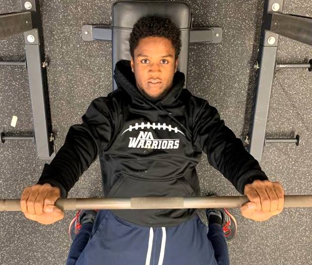 No Pain, No Gain: Senior football standout Wesley Horton knows full well the principle of preparing for the coming season months in advance. He pumps iron in the Warrior weight room to await his next gridiron battle.