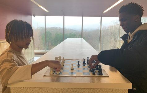 Checkmate: James Williams (9th) Jaden Cotton (12th) play chess in the hallways