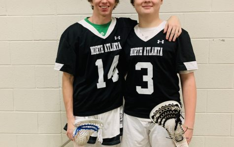 Team Tryouts: Sophomore Walter Mathews and sophomore Michael Pickens prepare for their lacrosse tryouts
