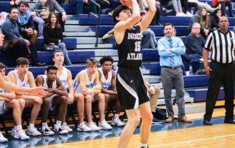Basketball Star:Charlie Hamilton hoists up a jumper versus Cambridge.