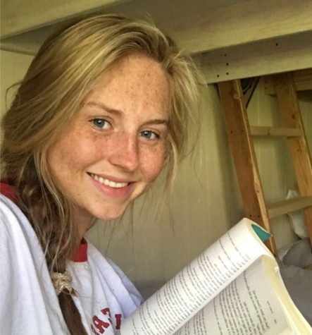No Place Like Home: There are downsides to a home-bound existence but North Atlanta students are finding there are some upsides. Junior Ellie Evans said she's finally found the time to read after she finishes her schoolwork.