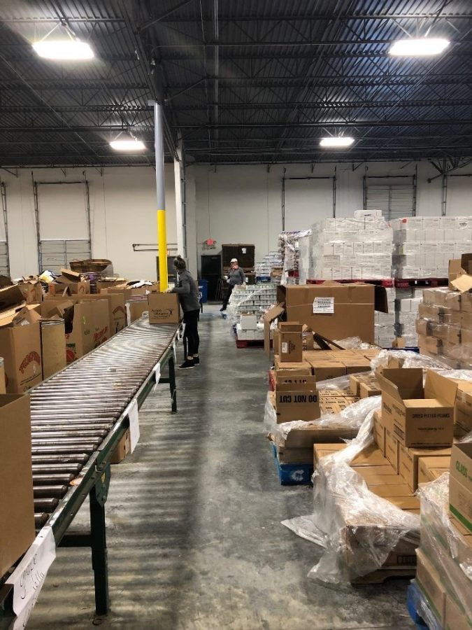 Caring for the Community: Warriors take safety precautions seriously while volunteering at the Atlanta Community Food Bank and other organizations.