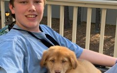 Pets of the Pandemic: Junior Holt Marbut enjoys some time outside with his new puppy, Blue.