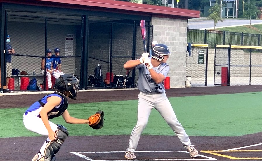 Off-Season Progress: Sophomore catcher Mason Ramos -- here taking some swings at the plate -- is part of a cohort of Warrior baseball players getting helpful playing time during intense fall league play.