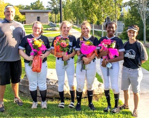 Night to Remember: What better way for the softball Dubs to celebrate their senior night than by putting an old-fashioned 13-0 drubbing on cross-town rivals Grady High School. The Class of 2021 seniors were part of a dramatic program turnaround for the school's softball program. From left to right are Coach Ricky Plante, Emily McGreevey, Katherine McWhirter, Jillian Dacey, Daishalyn Satcher and Coach Wren Williams.