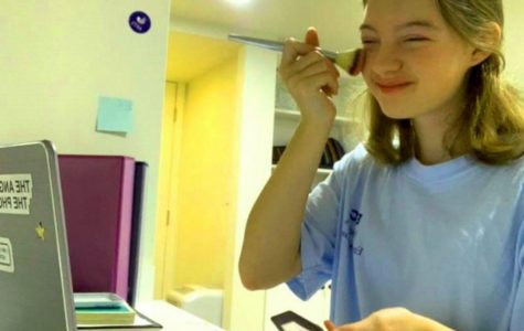 """She's Blushing: Junior Kathryn Ackerman does at least a semblance of """"get-ready"""" activities before joining her first class of the day on Zoom. Remote education has given students a whole new range of morning routines."""