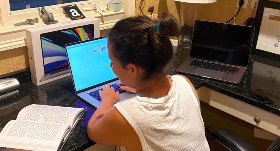 Sneak+a+Peek%3A+Virtual+education+opens+up+a+host+of+new...+educational+enhancements.+A+freshman+-+who+asked+to+remain+anonymous+-+takes+a+look+at+her+book+during+a+quiz