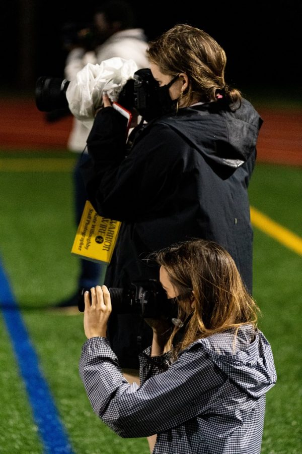Warrior Wire photographers Mady Mertens (front) and Kate Willoughby (back) on the sidelines chronicling the Pebblebrook game. The photographic team has been hard at work at each game chronicling the season for the 2020 Warriors football team.