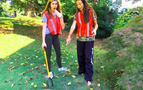 Earth Day Is Everyday: Seniors Caitlin Hohenstein (left) and Caitlin Krachon (right) are hard at work cleaning up their community.