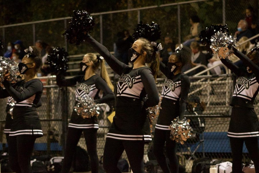 The cheerleaders, rockin' their new masks, gave it their all!