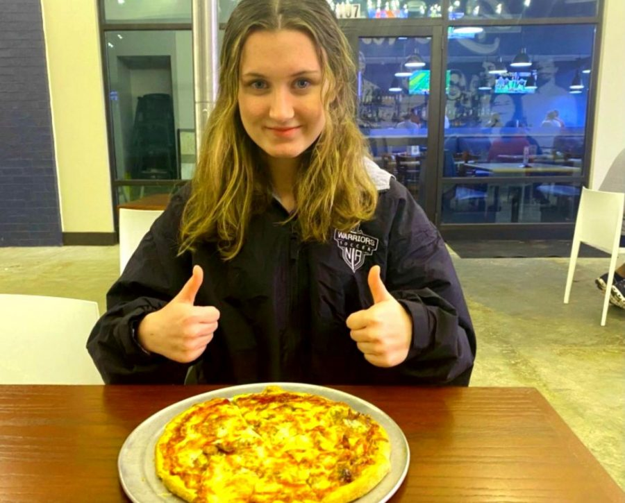 Let's Eat! Wire staffer sophomore Caroline Feagin gets ready to dive into a pizza pie from the popular pizza joint, Westside Pizza.