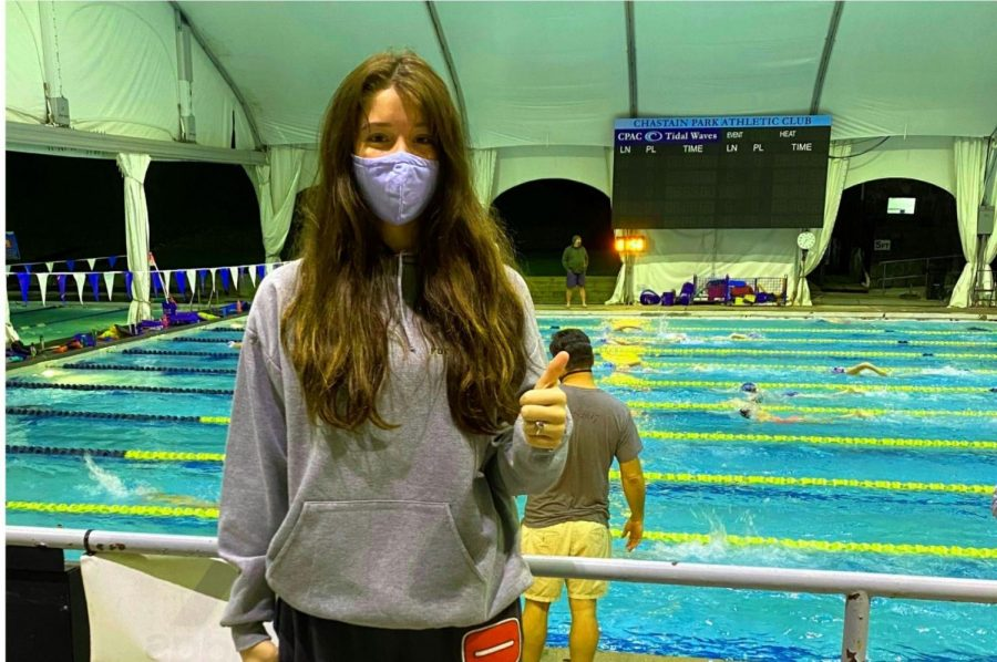 On+Deck%3A+Junior+Aislin+Ward+follows+proper+swimming+protocol+before+practice.+