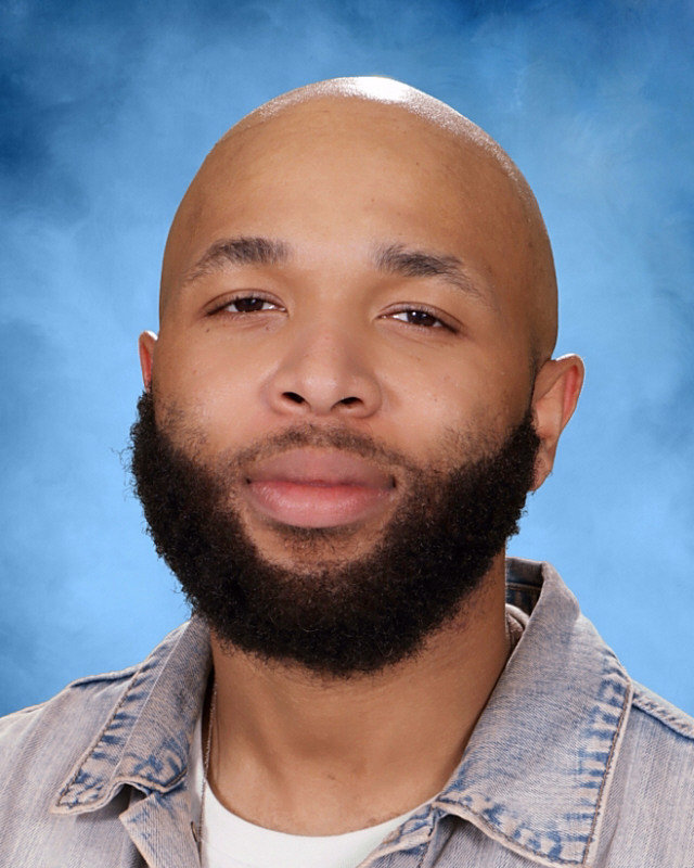 Educator of Excellence: Shown above is English-Language Arts teacher D'Andra McPhail. McPhail  is dedicated to the success of his students and embodies what it means to be apart of the Dubs community.