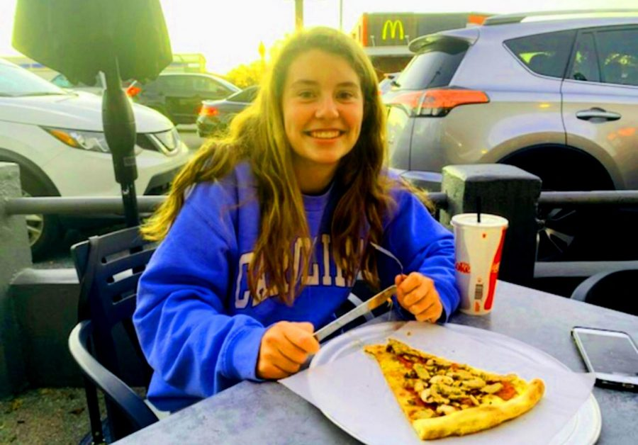 Dynamic Duo: Fellini's and La Fonda offer impressive and exciting dishes to the Atlanta area. Shown above is junior Josie Bird enjoying a nice slice of pizza on the Fellini's patio.