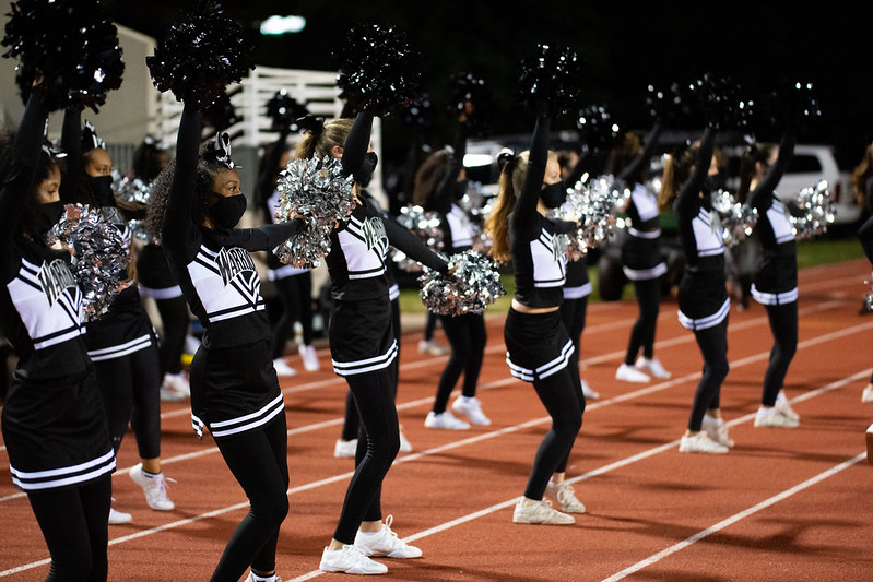 The Dubs wave their pom poms in celebration as the football team advances down the field at the October 16, 2020 game versus Tucker.