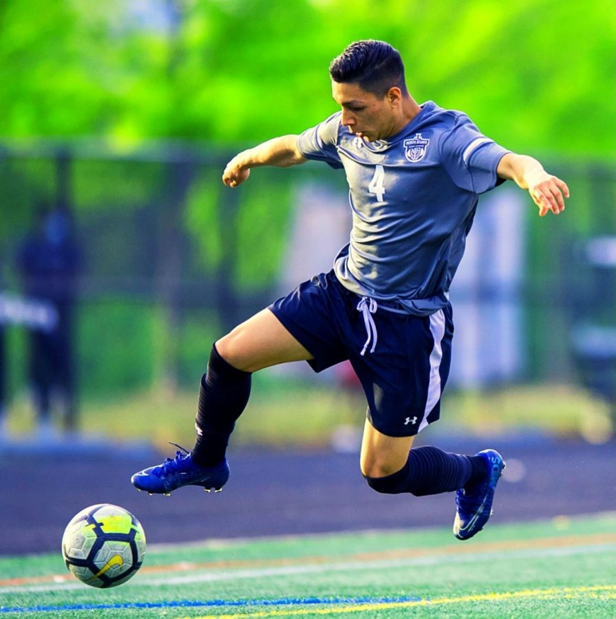 Tenacious Play: Sophomore defender Michael Garcia is tenacious at all times on the pitch. Here the skilled wingback makes a play for the ball in action against Northside in first-round playoff action.