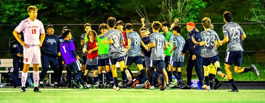 Sideline Euphoria: Dubs striker Jordan Chavez -- mobbed by his teammates -- strafes the North Atlanta sideline after scoring the winning overtime goal in the team's 1 to 0 quarterfinals win over Allatoona on May 5.