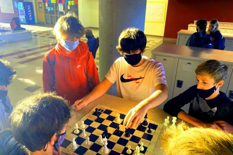Sport of Kings: Freshmen Wyatt Welch, Jacob Weathington, Jack Shultz, Hunter Black are part of an early-morning group of chess players who match wits before first period.