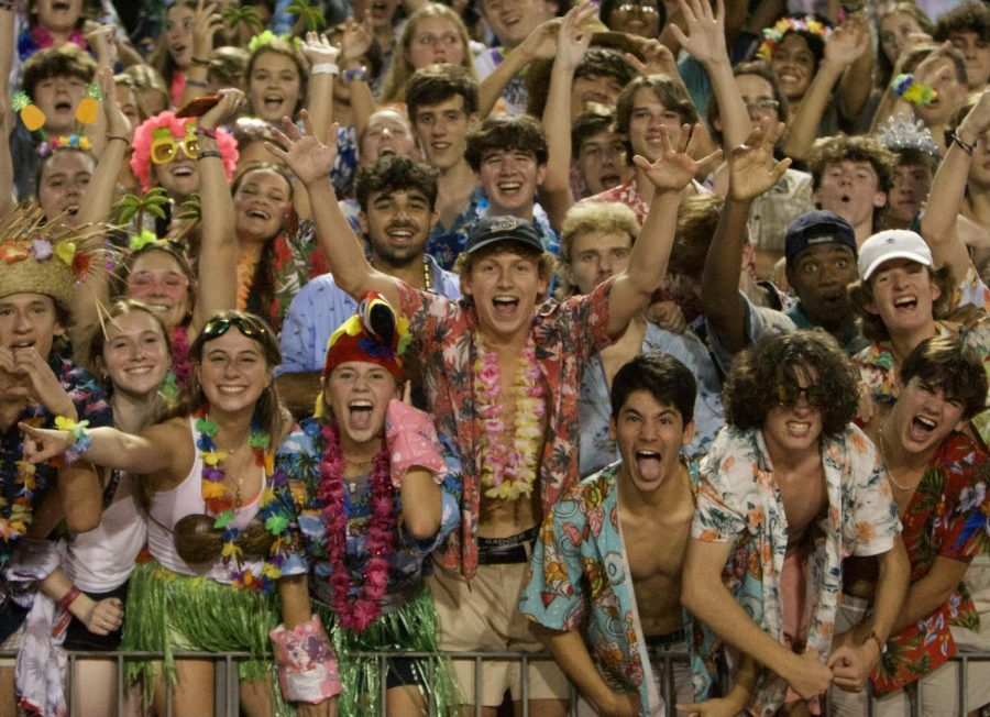 Welcome Back Warriors: The Dubs show out in full luau attire to demonstrate their support at the first football game to have a student section in nearly two years. The Warriors took home the dub, winning the opening-season game 10-7 against Wheeler High School.
