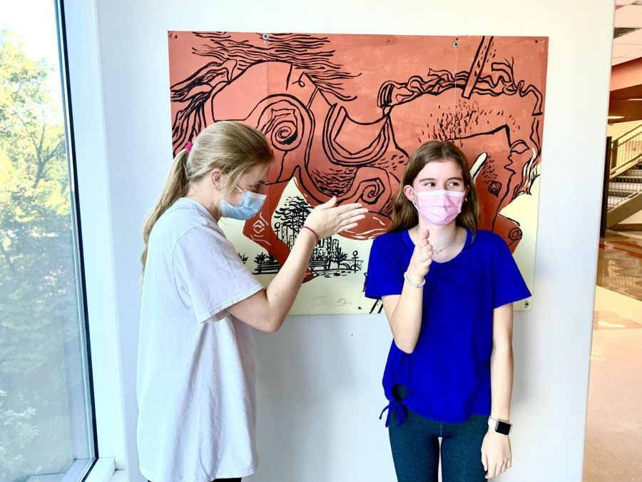 POV: Juniors Caroline Edwards and Elizabeth Ackerman demonstrate Boi, one of the many new terms in teens current diverse vocabulary.