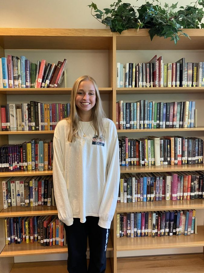 Heavenly+Hideaways%3A+Senior+Anna+Yoder+has+worked+in+the+library+since+her+freshman+year%2C+finding+the+quiet+atmosphere+and+resources+useful+for+studying.+
