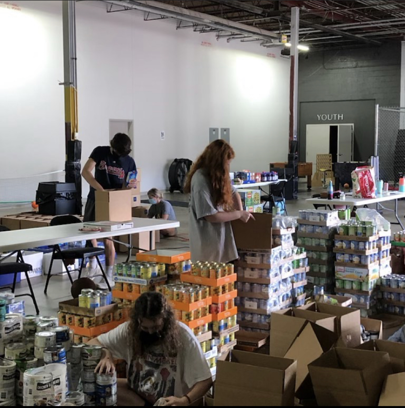 Lending a helping hand: Operation Feed has extended their organization to include NAHS students serving as ambassadors. These Dubs are hard at work helping APS families in need.