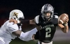 Dual Threat: Warrior quarterback Trey Lennon shows off his playmaking ability with a stiff-arm. He's been at the heart of the team's strong unbeaten showing early in the 2022 campaign.